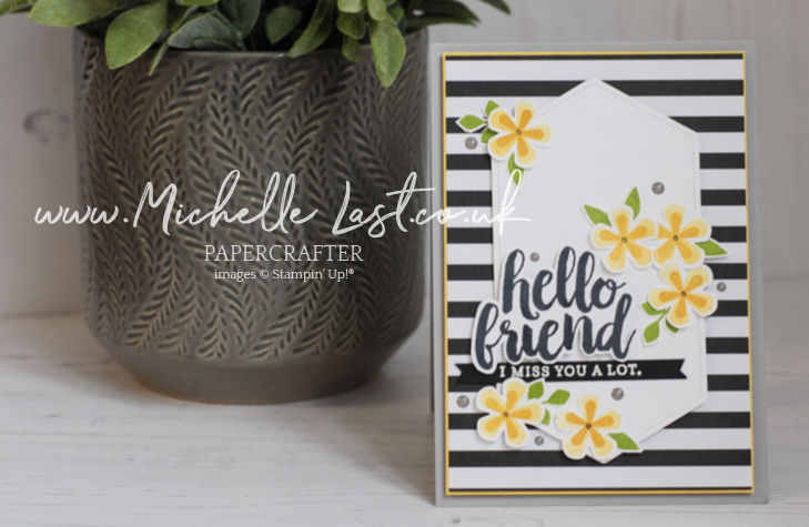 handmade card with flower punches on it