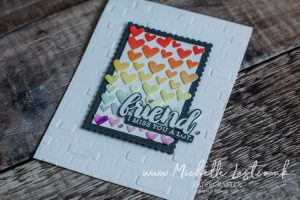 A card created with hearts in rainbow colours