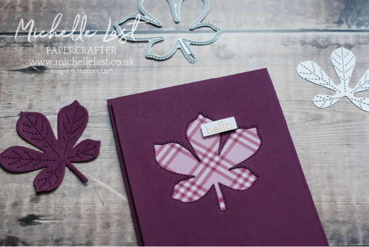 A handmade card with a leaf on the front