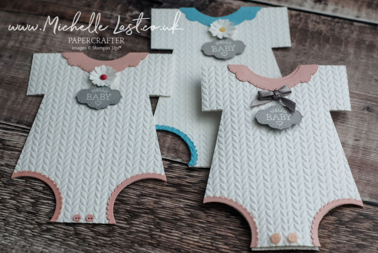 Baby card in the shape of a baby grow