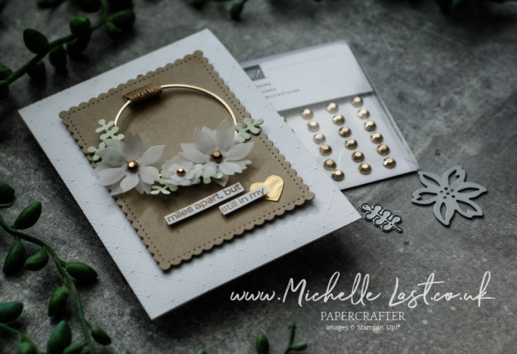 Handmade card with a floral wreath on the front
